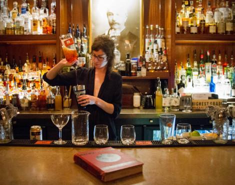 Bartender Hannah Howard mixes a series of cocktails, from left, a Dirty Martini, Rhett Butler, Sazerac, and Whiskey Smash for customers the Peter Kern Library in downtown Knoxville on Thurs,. Oct. 8, 2015.
